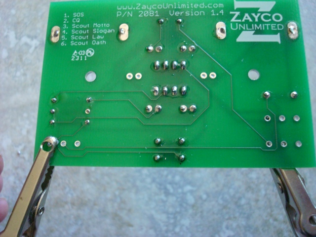 A picture of the soldered button.